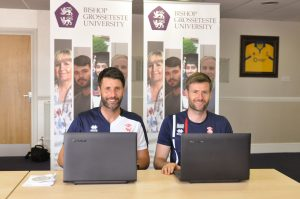 Danny and Nicky Cowley with laptops provided to the Imps by BGU